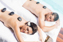 Couple getting a hot stone massage Royalty Free Stock Photo