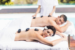 Couple getting a hot stone massage Royalty Free Stock Photos