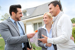 Couple getting keys of new home Stock Photos