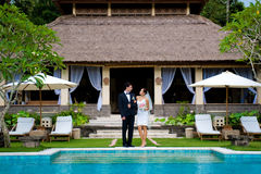 Couple Getting Married. An attractive bride and groom smiling at each other at a villa outdoors Stock Photo