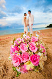 Couple Getting Married. An attractive bride and groom getting married by the beach Stock Photography