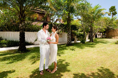 Couple Getting Married. An attractive bride and groom getting married outdoors Stock Image
