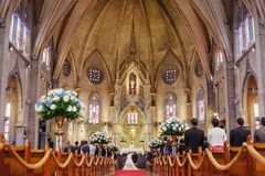 Couple getting married in a beautiful gothic church stock image