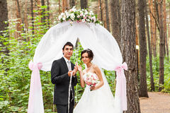 Couple Getting Married at an Outdoor Wedding Stock Photo