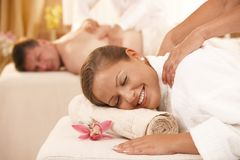 Couple getting massage. Happy couple having back massage in day spa