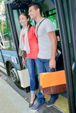 Couple getting off bus. Couple getting off a bus Stock Photo