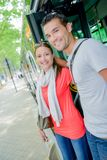 Couple getting off bus. Couple getting off a bus Stock Photography