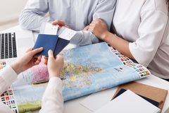 Couple getting passports and tickets in travel agency. Closeup stock images