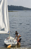 Couple Getting Ready To Go Sailing - Vertical Stock Images