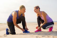 Couple getting ready for training outdoors stock photography
