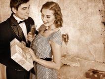 Couple with gift box.  Black and white retro Royalty Free Stock Photos