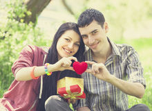 Couple with gift at green grass Royalty Free Stock Images