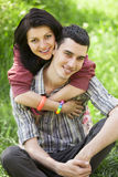 Couple with gift at green grass Royalty Free Stock Image