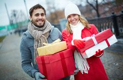 Couple with giftboxes Stock Photography
