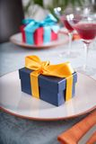 Couple of gifts at restaurant Stock Images
