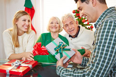 Couple with gifts and seniors at christmas Stock Photography