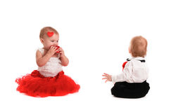 Couple girl and boy babies playing with hearts concept valentine Stock Photo