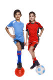 Couple of girl and boy dressed in soccer equipment Royalty Free Stock Photo