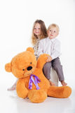 Couple girl and boy are having fun with big teddy Royalty Free Stock Photo