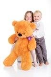 Couple girl and boy are having fun with teddy bear Stock Photos