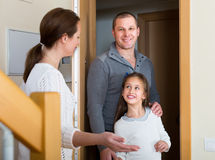 Couple with girl at doorway Stock Images
