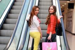 Couple girl friend walking escalator and shopping Stock Photos