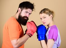 Couple girl and hipster practicing boxing. Sport for everyone. Amateur boxing club. Equal possibilities. Strength and. Power. Man and women in boxing gloves. Be royalty free stock photos