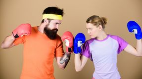 Couple girl and hipster practicing boxing. Sport for everyone. Amateur boxing club. Equal possibilities. Strength and. Power. Man and women in boxing gloves royalty free stock photos