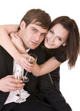 Couple of girl and man kiss and drink wine. Stock Photos