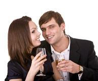 Couple of girl and man kiss and drink wine. Royalty Free Stock Image