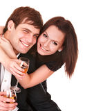 Couple of girl and man kiss and drink wine. Stock Photography