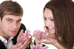 Couple of girl and man love flower. Royalty Free Stock Images