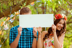 Couple girl and man with white sign in his hands Stock Images