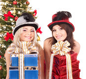 Couple girl in party hat holding stack gift box. Royalty Free Stock Photos