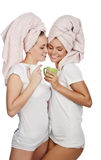 Couple of girl with towel on head and mug. Couple of caucasian girl with towel on head and mug ,isolated on white Royalty Free Stock Photo