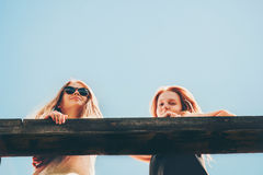 Couple girls friends walking together enjoy summer stock photography