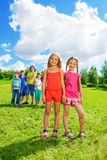 Couple girls and group of friends Royalty Free Stock Images