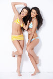 Couple girls having fun with posing Royalty Free Stock Photos