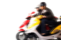Couple girls racing on electric scooter. Over white background - motion blur Stock Images