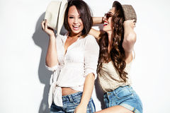 Couple of girls in summer clothes Stock Photos