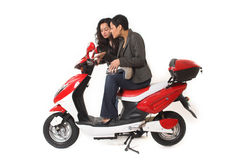 Couple girls talking on  scooter. Over white background Stock Images