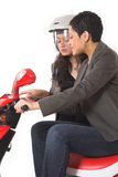 Couple girls talking on  scooter. Over white background Royalty Free Stock Images