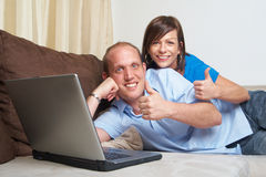 Couple gives thumbs up Royalty Free Stock Images