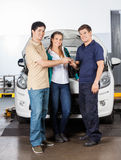 Couple Giving Car Keys To Technician royalty free stock images