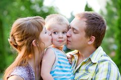 Couple giving and children outdoors Royalty Free Stock Images