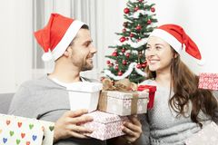 Couple giving christmas presents Royalty Free Stock Photo