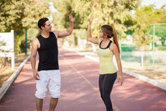 Couple giving each other a high five Royalty Free Stock Image