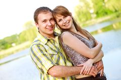 Couple giving outdoors smiling Royalty Free Stock Image