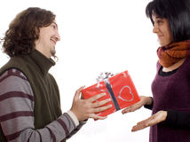 Couple giving a present Royalty Free Stock Images