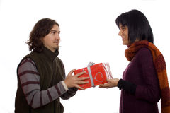Couple giving a present. Young man giving a present to a pretty woman Royalty Free Stock Photography